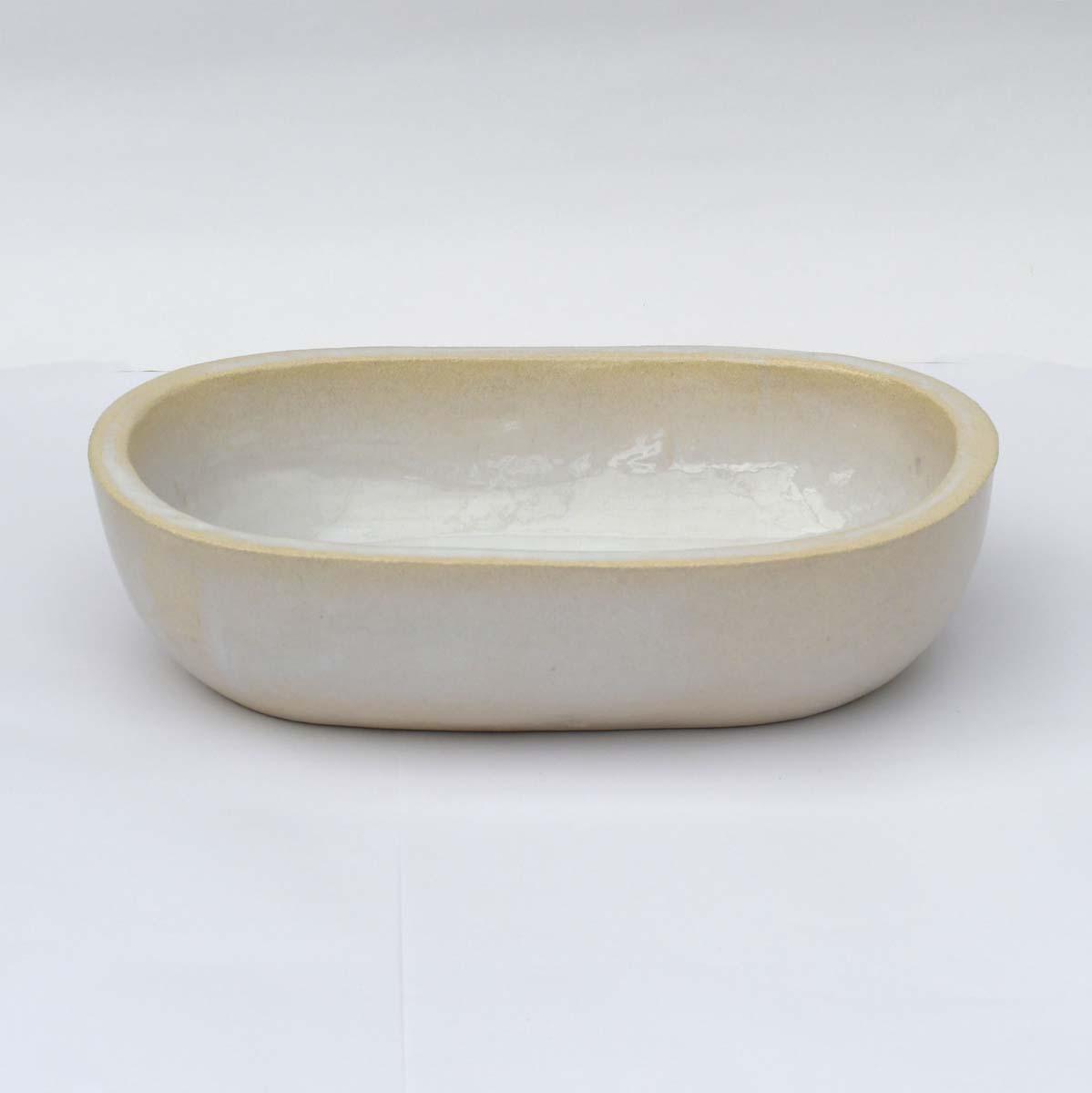 כיור אמבטיה קטן אובאלי בצבע לבן